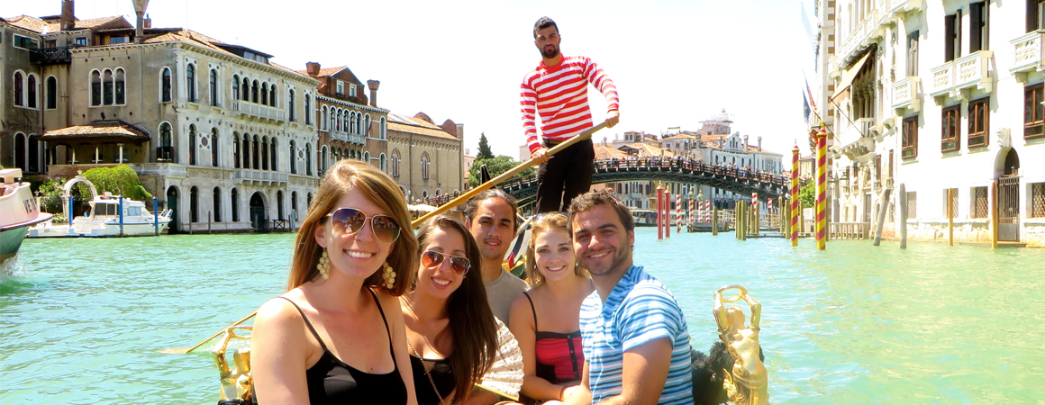 Students riding in a gondola in Venice